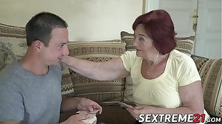 Redhead granny and her boy toy waste no time fucking hard