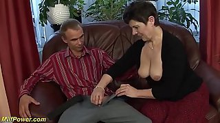 big ass horny mature enjoys a big dick from her young toyboy deep inside her hairy bush cunt