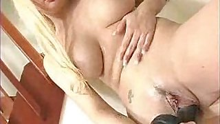Busty blonde Tatiana Stone playing with black dildo