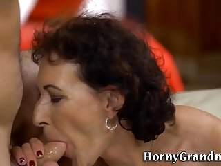 Pussy rubbed mature lady gobbles cock