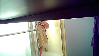 Son sets up spycam in shower to see mom's huge tits