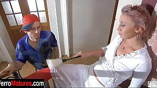 Stockinged milf seducing a guy with her topless look into a hot cock break