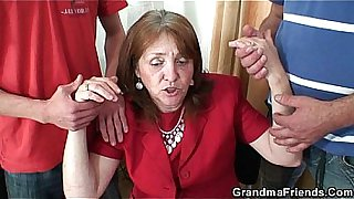 Busty granny in stockings rides and sucks at same time